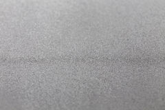 Foco selectivo texturizado industrial frío moderno brillante del fondo del brillo metálico de plata gris Imagen de archivo
