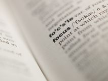 Focus. Dictionary view, definition, catchword Stock Photos