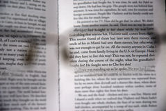In focus. View through a pair of reading glasses showing focused text Stock Photo