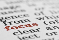 Focus. Macro of the word focus in the dictionary, with entire image in black and white apart from the word focus, which is in red Royalty Free Stock Photos