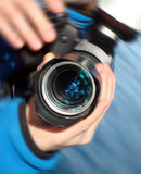 In focus. Objective of a camera, with reflection of water in a lens royalty free stock images
