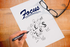 Focus against currency symbols Royalty Free Stock Image