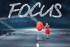 Focus against road leading out to the horizon Royalty Free Stock Photography