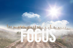 Focus against stony path leading to large urban sprawl under the sun. The word focus against stony path leading to large urban sprawl under the sun Royalty Free Stock Photography