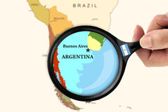Focus in Argentina. Magnifying glass over a map of Argentina Royalty Free Stock Photo