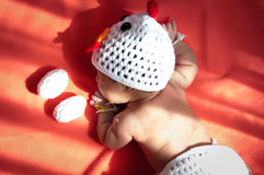 Focus at Asian newborn baby girl with costumes Chicken with two eggs beside the window with sunlight Royalty Free Stock Photos