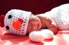 Focus at Asian newborn baby girl with costumes Chicken with two eggs beside the window with sunlight Stock Image