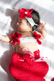 Focus at Asian newborn baby girl with costumes little mermaid in red color beside the window with sunlight Stock Images