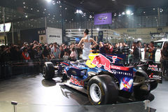 Focus of auto show. Picture of auto show 2011. Zhengzhou. China. Many people are attracted by model and red bull racing F1 car royalty free stock images