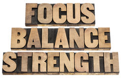Focus, balance, strength. Performance concept - isolated text in letterpress wood type printing blocks royalty free stock photography