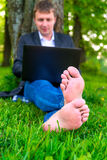 Focus on bare feet of a businessman Royalty Free Stock Photos