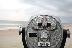 Focus on the beach. You can see  long way with these stationary binoculars Stock Photo