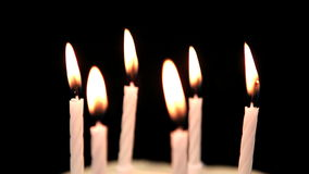 Focus on birthday candles being blown out Stock Photos