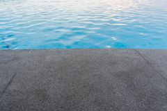 Black granite stone pool edge. Focus on black granite stone pool edge  background used for display or montage object Royalty Free Stock Images