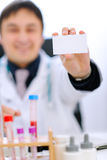 Focus on blank business card on hand of doctor Stock Photos
