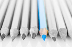 Focus at blue colored pencil with no colored pencil. Royalty Free Stock Images