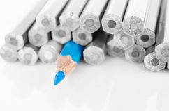 Focus at blue colored pencil with no colored pencil. Royalty Free Stock Photo