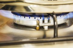 Focus of blue flame gas on a cooker boiling pot in kitchen gas s. Tove. Cooking Food Stock Photos