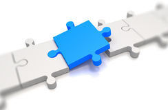 Focus on a blue puzzle pieces Royalty Free Stock Photos