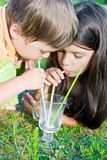 Girl and boy drink milk Stock Photography