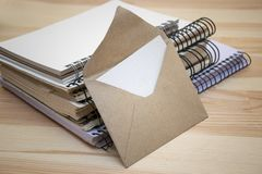 Opened letter and set of notebooks with binders stock images