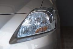Focus on the bulb of car headlight.  Royalty Free Stock Photos