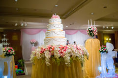 Focus the cake in wedding ceremony. pink color theme wedding party. With wonderful cake. symbol of wedding day concept. image for background, wallpaper and copy Royalty Free Stock Photography