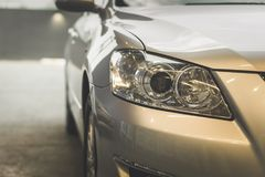 Focus on the car headlights on a street Royalty Free Stock Photography