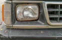 Focus on the car headlights on a street Stock Photos