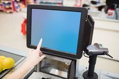 Focus on a cashiers screen Stock Photo
