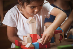 Focus on child`s hand  playing with colorful wooden blocks Stock Image