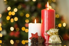 Focus on christmas candles and decorations. At home in the living room royalty free stock photo