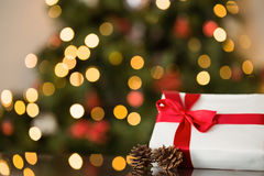Focus on christmas gift and pine cone Stock Images