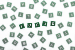 Focus  - Clear Letters Against Blurred Royalty Free Stock Image