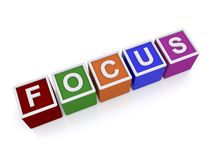 Focus in colored block letters Stock Image