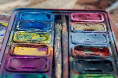 Focus on colour and texture. Artisans tools of his trade and the focus on colours and texture of the drying acrylic paint Stock Image