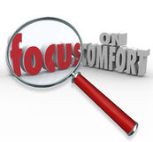 Focus on Comfort Words Magnifying Glass Relax Pleasing Luxury. Focus on Comfort words under a magnifying glass communicating luxury, relaxation, pleasing Stock Images