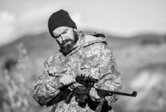 Focus and concentration of experienced hunter. Hunting and trapping seasons. Hunting masculine hobby. Man brutal. Gamekeeper nature background. Bearded hunter royalty free stock photo