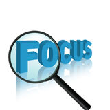 Focus concept. The word focus with a magnifying glass Royalty Free Stock Images