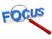 Focus concept with magnifier. Word focus and magnifying glass Royalty Free Stock Images