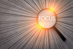 Focus concept with magnifying glass Royalty Free Stock Image