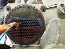 Focus on the Condenser Tube, Cleaning Chiller Condenser Tubes with Brushs stock photos
