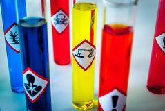 Focus on corrosive danger. Multicolored Chemistry vials - Focus on corrosive danger stock photo