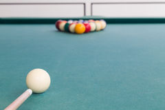 Focus on cue aiming white ball to break snooker billards Stock Images