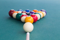 Focus on cue aiming white ball to break snooker billards. On green table Stock Image