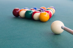 Focus on cue aiming white ball to break snooker billards. On green table Stock Photo