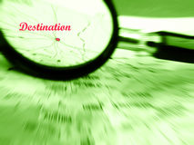 Focus on destination. A conceptual image of the focusing on the travel destination. Taken with a magnifying glass and a map with roads converging on a location Stock Images