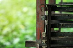 Focus detailing of wooden stairs. And background images are trees and nature. royalty free stock photography