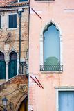 Vertical: Intricate art and sculptures adorn the historic buildings in Venice, Italy. Focus on details of Venetian artistry on display throughout the city Stock Image