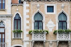 Intricate art and sculptures adorn the historic buildings in Venice, Italy. Focus on details of Venetian artistry on display throughout the city streets and Royalty Free Stock Images